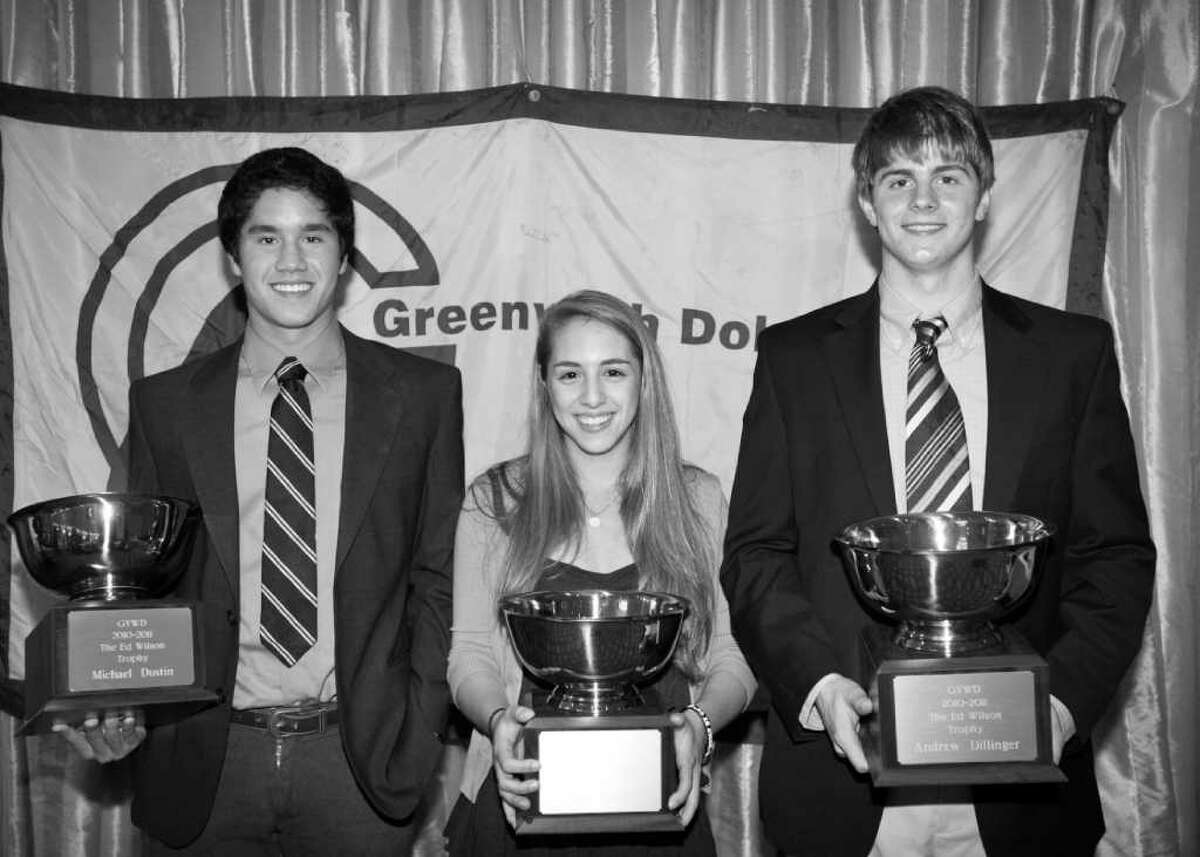 The YWCA Greenwich Dolphins Swim Team 2011 Ed Wilson Trophy, which goes to those who best exemplify sportsmanship, team spirit and enthusiasm, was recently presented to, from left, Michael Dustin, Kate Madoff and Andrew Dillinger.