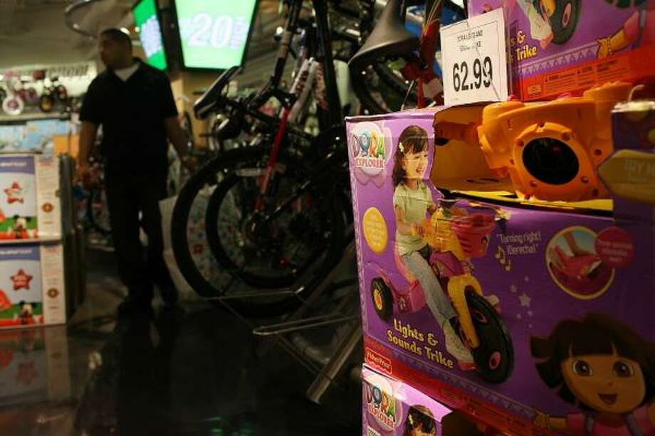 A Fisher-Price Dora the Explorer model tricycle is displayed Thursday at a store in New York. Fisher-Price announced the recall of 10 million toys and baby items because of safety issues. Photo: Spencer Platt, Getty Images