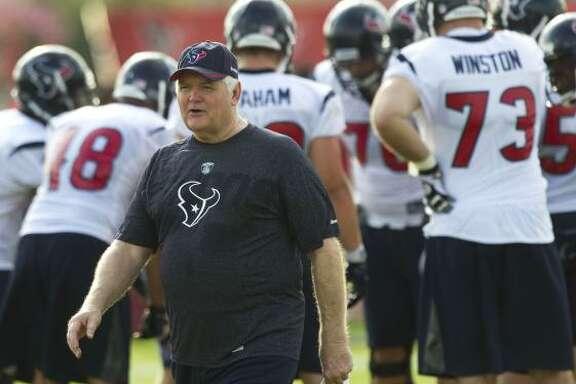Houston Texans defensive coordinator Wade Phillips walks across the field during Texans training camp at the Methodist Training Center. Brett Coomer/Houston Chronicle