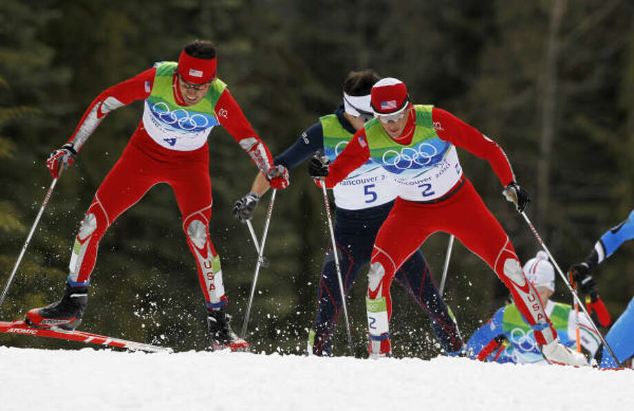 U.S. silver medal winner Johnny Spillane, left, skis during Sunday's cross-country portion of the Nordic combined individual normal hill event. Photo: Matthias Schrader, AP