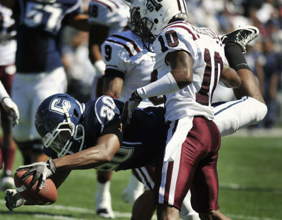 UConn scored the first five times it had the ball, and held the TiSU (0-2) to just a single first down in the first half. Photo: Jessica Hill, AP