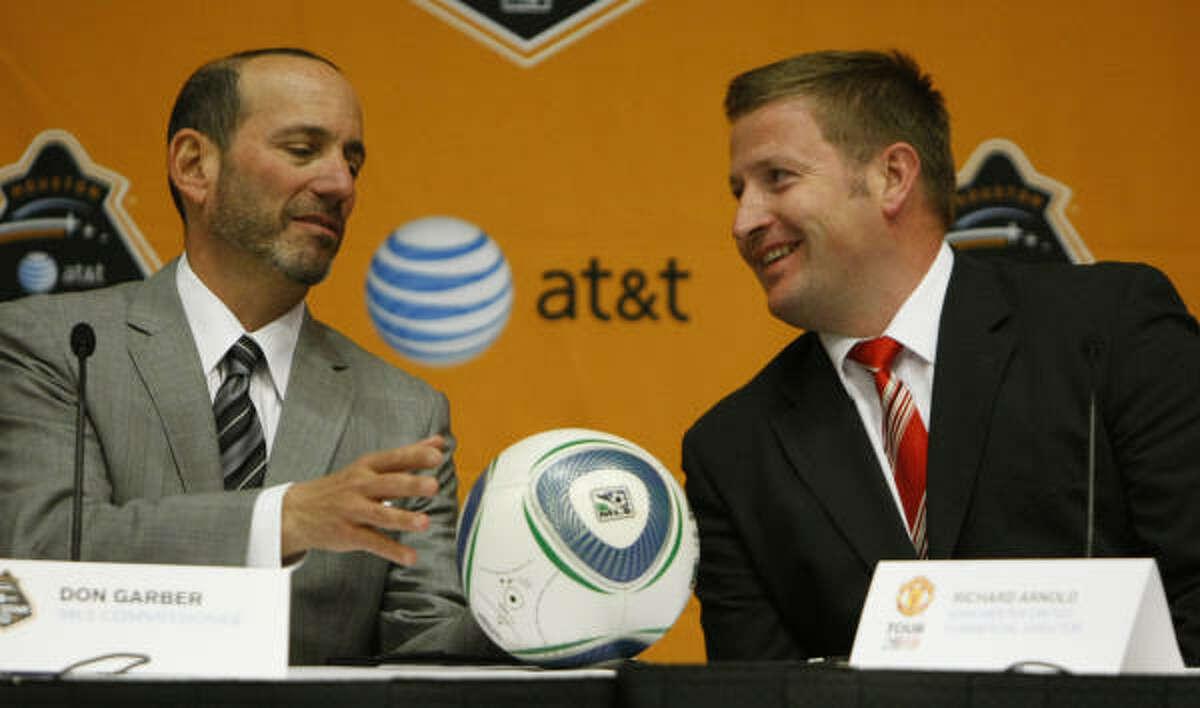 MLS commissioner Don Garber, left, has emphasized building soccer-specific stadiums.