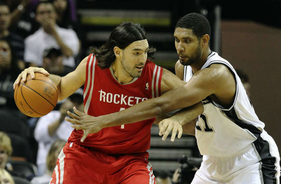 Luis Scola and the Rockets face Tim Duncan and the Spurs on Nov. 6, the first of four meetings between the two Southwest division rivals. Photo: KIN MAN HUI, SAN ANTONIO EXPRESS-NEWS