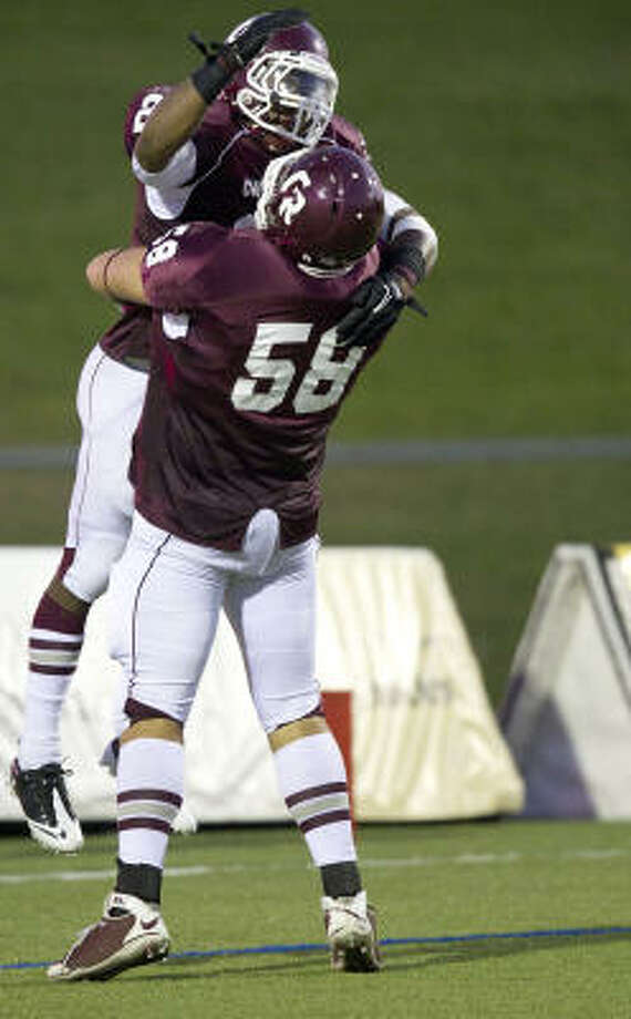 Cinco Ranch running back  K.C. Nlemchi (25) celebrates with lineman Tyler Knowles (58) after rushing for a touchdown against Klein Forest. Photo: Smiley N. Pool, Chronicle