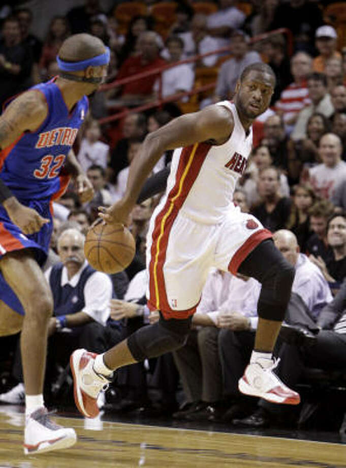 Miami Heat guard Dwyane Wade drives past Detroit Pistons guard Richard Hamilton during the first quarter on Tuesday. Photo: Lynne Sladky, AP