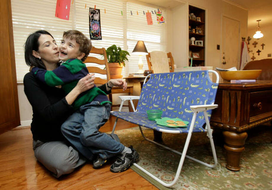 Michelle Groogan gets a hug from her son, Garrett Groogan, 6, during snack time. Garrett is mostly non-verbal autistic, but a gluten-free, casein-free diet seems to be easing some of his more distressing symptoms. Photo: MELISSA PHILLIP, CHRONICLE