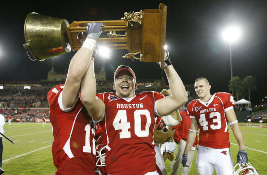 UH assistant Jason Phillips, not pictured, has helped the Cougars regain respect and the Bayou Bucket. Photo: Chronicle File Photo