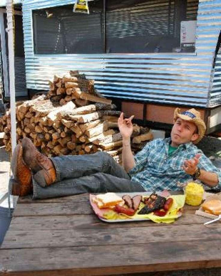 The Daytripper host Chet Garner enjoys some trailer barbecue. Photo: SARAH HARDIN