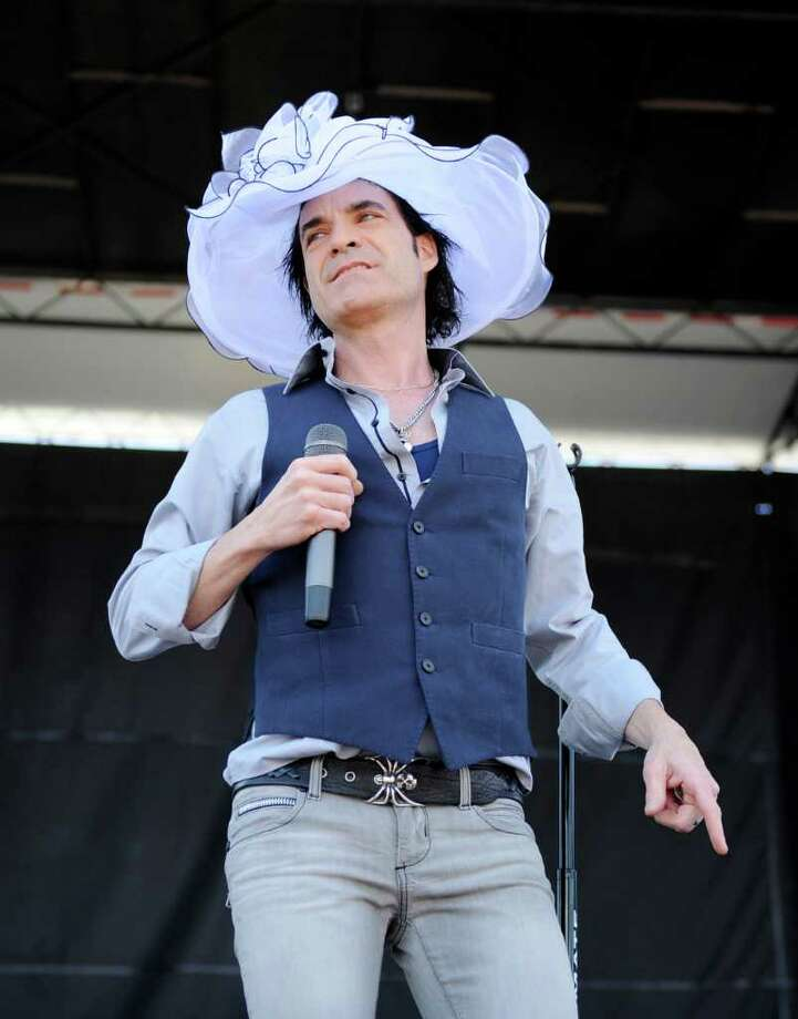 Patrick Monahan of the rock group Train performs at Pimlico Race Course, Saturday, May 21, 2011, in Baltimore. Train is performing in the infield of the 136th Preakness Stakes horse race. (AP Photo/Nick Wass) Photo: Nick Wass / FR67404 AP