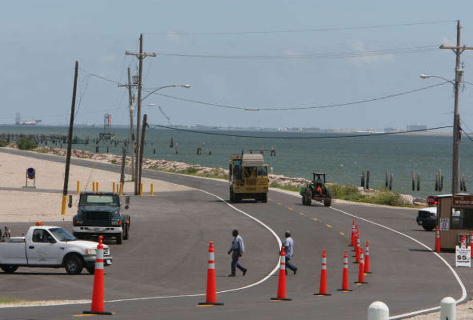 Crews work Friday on the renovated Texas City Dike. Photo: Julio Cortez, Chronicle
