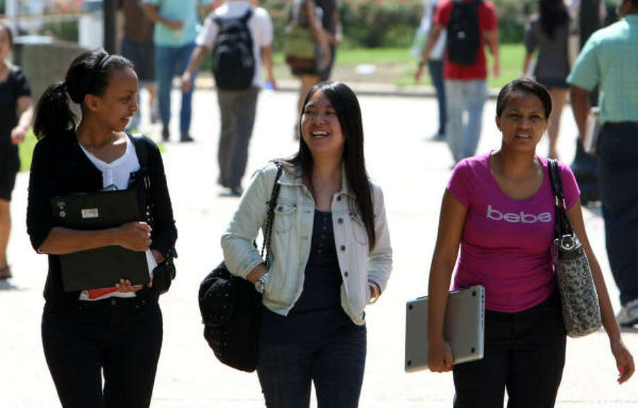 Samra Tesfamariam, left, Eugenia Tham and Suzan Cruz share the same major but bring different ethnic backgrounds to the University of Houston. Photo: Julio Cortez, Chronicle