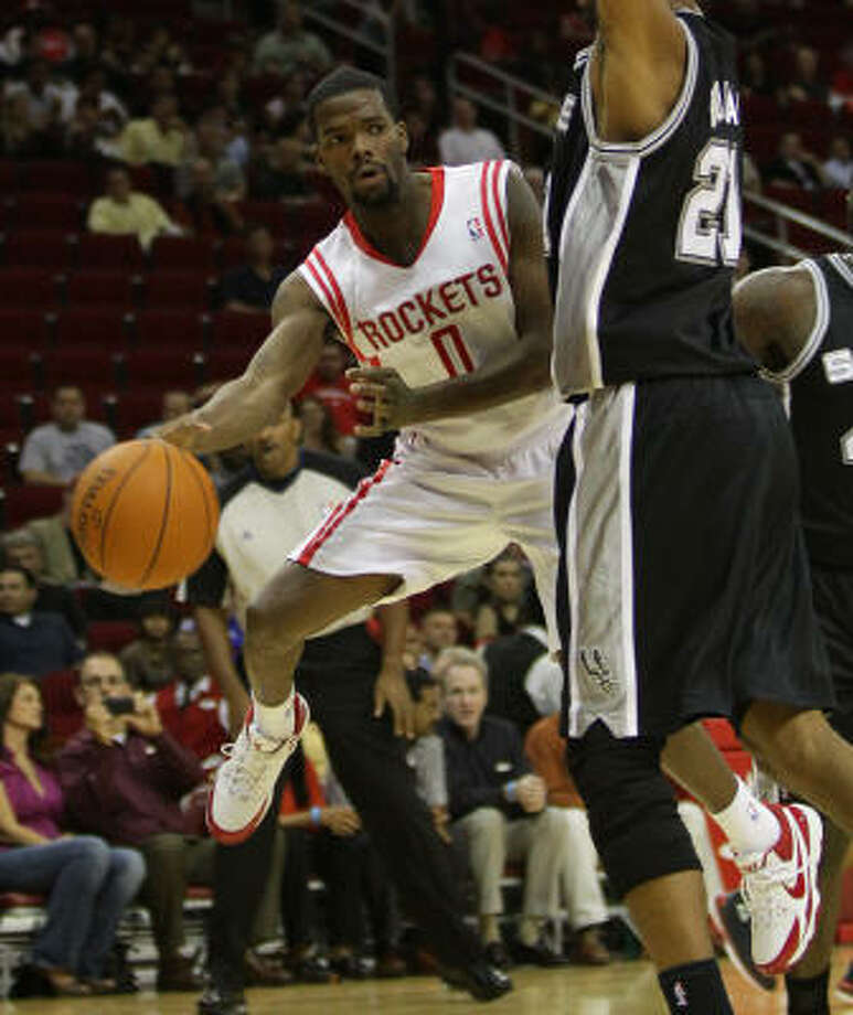Rockets point guard Aaron Brooks, left, and backcourt mate Kevin Martin will have to step it up on defense, columnist Jerome Solomon writes. Photo: Nick De La Torre, Chronicle