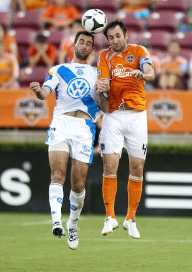 Defender Ryan Cochrane and the Dynamo set the bar high in  SuperLiga  play. Photo: Brett Coomer, Chronicle