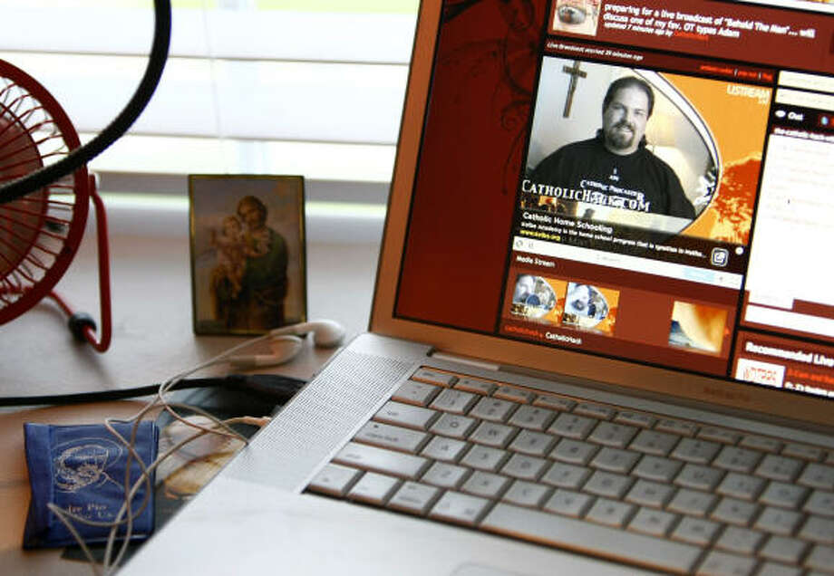 "Joe McClane runs his website The Catholic Hack (www.catholichack.com) from his home in Spring. When McClane created Catholic Hack in 2002, it was one of only a handful sites offering Catholic podcasts. ""Most folks think they couldn't start a blog or a podcast which is designed to share their faith. I love to show them that they can. I mean, if a hack like me can do it … anybody can, right?"" he said. Photo: Karen Warren, Chronicle"