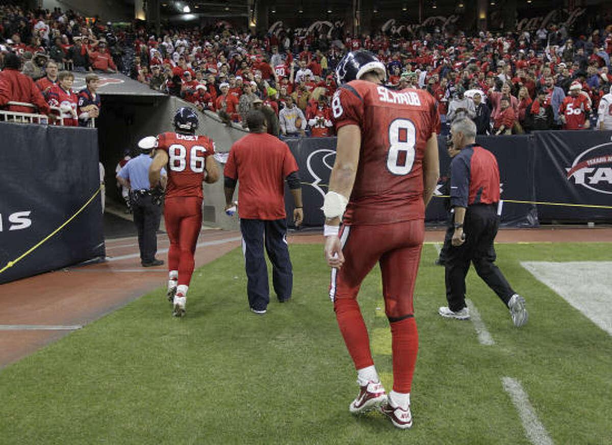 Texans quarterback Matt Schaub walks off the field after the loss in overtime on Monday night.