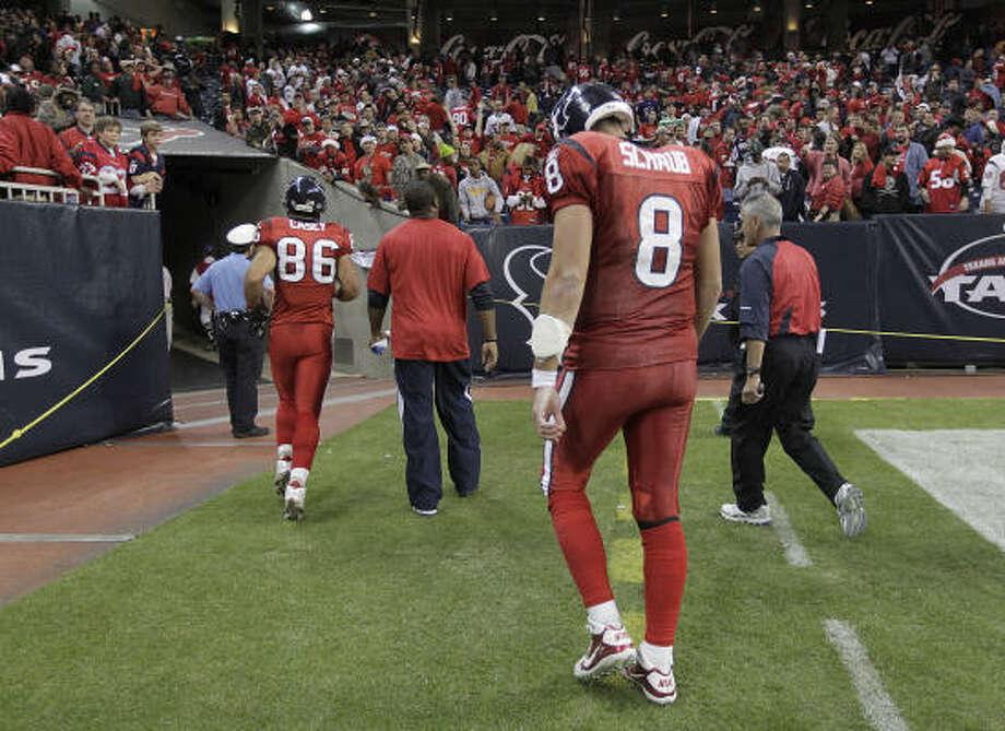 Texans quarterback Matt Schaub walks off the field after the loss in overtime on Monday night. Photo: Karen Warren, Chronicle