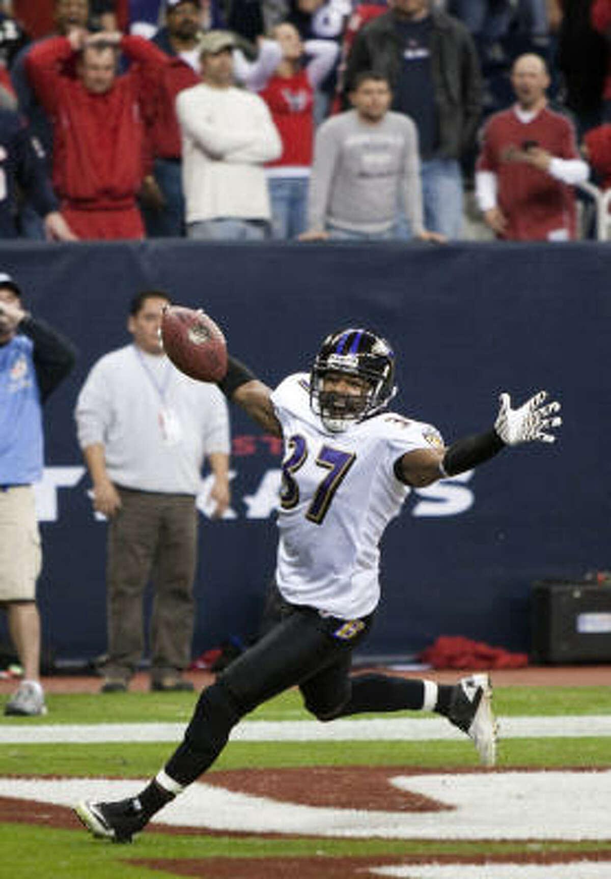 Ravens cornerback Josh Wilson celebrates his 12-yard interception return for a touchdown of a Matt Schaub pass during overtime on Monday night.