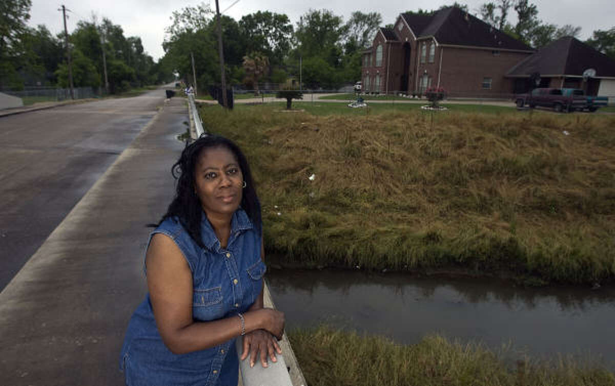"""Deborah Butler is among the Kashmere Gardens residents along Hunting Bayou whose homes are in the way of bayou expansion. The county wants to buy her home and pay moving and real estate costs. """"We don't want to move,"""" Butler said. """"At any price."""""""