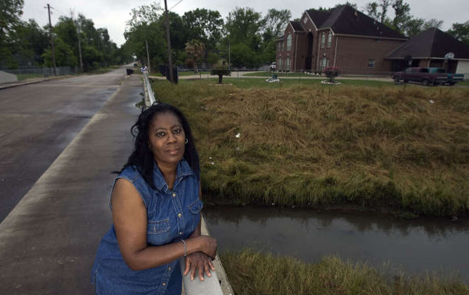 "Deborah Butler is among the Kashmere Gardens residents along Hunting Bayou whose homes are in the way of bayou expansion.  The county wants to buy her home and pay moving and real estate costs. ""We don't want to move,"" Butler said. ""At any price."" Photo: James Nielsen, Chronicle"