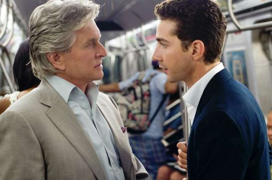 Michael Douglas portrays Gordon Gekko, left, and Shia LaBeouf portrays Jake Moore Wall Street: Money Never Sleeps. Photo: Barry Wetcher :, 20th Century Fox