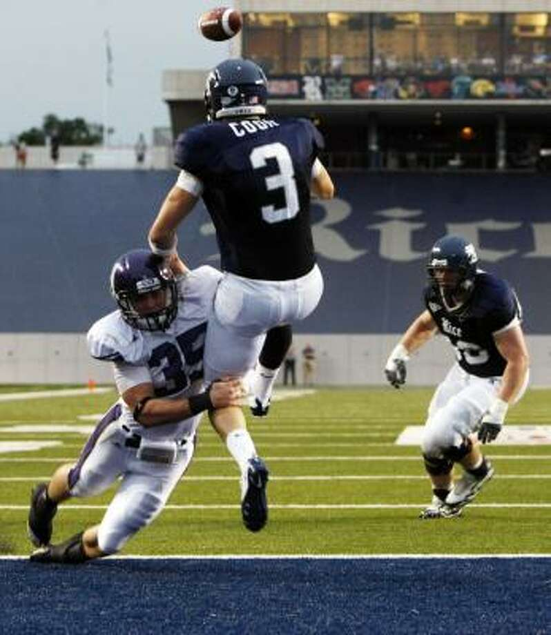 Rice quarterback Taylor Cook is hit by Northwestern's Ben Johnson while throwing the ball out of the end zone in the second quarter. Photo: Johnny Hanson, Chronicle