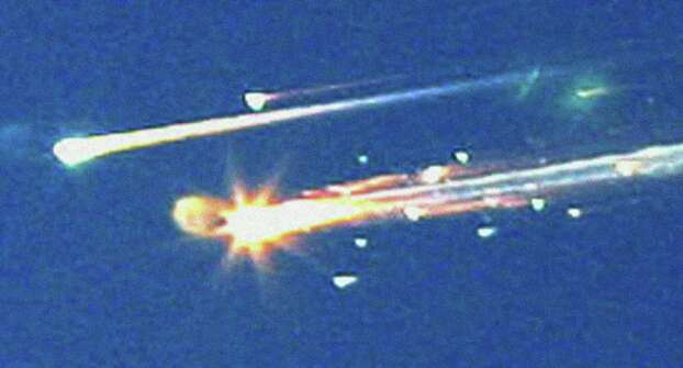 FILE - In this Saturday, Feb. 1, 2003 file photo, debris from the space shuttle Columbia streaks across the sky over Tyler, Texas. Photo: AP