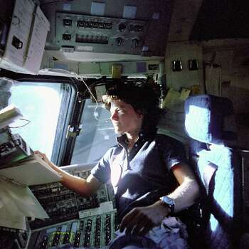 FILE - In this June 1983 photo provided by NASA, astronaut Sally Ride, a specialist on shuttle mission STS-7, monitors control panels from the pilot's chair on the shuttle Columbia flight deck. Ride became America's first woman in space when Columbia launched June 18, 1983. Photo: AP