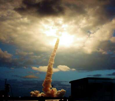 FILE - In this Friday, March 1, 2002 file picture, the space shuttle Columbia illuminates a cloud during its morning liftoff at the Kennedy Space Center in Cape Canaveral, Fla. Photo: AP