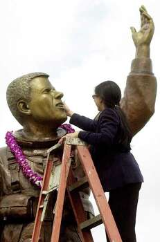 Lani McCool, widow of astronaut William C. McCool killed in the Shuttle Columbia disaster Feb. 1, 2003, touches the face of a statue of his likeness unveiled in Lubbock, Texas, Saturday, May 8, 2005. U. S. Navy Cmdr. Willie McCool, who grew up in Lubbock, was the pilot of the shuttle that broke up over Texas upon re-entry.  McCool's family, others who lost loved ones in the shuttle disaster, and a number of NASA astronauts and officials from the Johnson Space Center in Houston were present for the ceremonies. Photo: JOE DON BUCKNER, AP / LUBBOCK AVALANCHE-JOURNAL