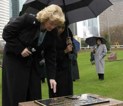 Space Shuttle Columbia widows Evelyn Husband, left, and Sandy Anderson get their first look at a memorial dedicated to the Columbia astronauts Tuesday, Feb. 1, 2005, in downtown Houston, two years after the spacecraft came apart on re-entry.  All seven astronauts died in the accident. Photo: PAT SULLIVAN, AP / AP