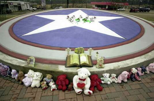 ** ADVANCE FOR MONDAY FEB. 2 ** Flowers, stuffed animals, crosses and scriptures have been placed around a large star marker, Friday, Jan. 30, 2004, in Hemphill, Texas. Many of the items are tokens of sympathy for the seven astronauts who lost their lives Feb. 1, 2003, when the space shuttle Columbia broke apart over Texas. An Air Force flyover followed by a moment of silence will mark the one-year anniversary of when the space shuttle Columbia broke apart over Hemphill. Photo: JOEL ANDREWS, AP / AP