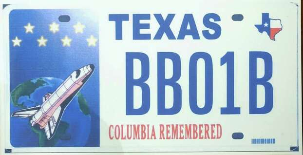 This is a copy of the Texas license plate, unveiled on Friday, Jan. 30, 2004, in Austin, Texas.  It honors the crew of the space shuttle Columbia which disintegrated over Texas last year killing seven astronauts. Photo: HARRY CABLUCK, AP / AP