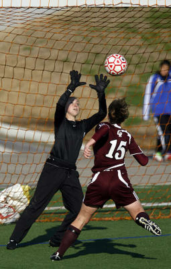 Cinco Ranch's Jamie Byers bumps the game-winning goal past The Woodlands' goaltender Mallory Garthwaite. Photo: Johnny Hanson, Chronicle