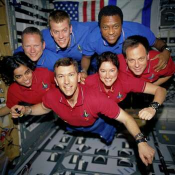 The STS-107 crewmembers strike a 'flying' pose for their traditional in-flight crew portrait in the SPACEHAB Research Double Module (RDM) aboard the Space Shuttle Columbia. From the left (bottom row), wearing red shirts to signify their shift's color, are astronauts Kalpana Chawla, mission specialist; Rick D. Husband, mission commander; Laurel B. Clark, mission specialist; and Ilan Ramon, payload specialist. From the left (top row), wearing blue shirts, are astronauts David M. Brown, mission specialist; William C. McCool, pilot; and Michael P. Anderson, payload commander. Ramon represents the Israeli Space Agency. EDITOR'S NOTE: On February 1, 2003, the seven crewmembers were lost with the Space Shuttle Columbia over North Texas. This picture was on a roll of unprocessed film later recovered by searchers from the debris. Photo: AP / NASA