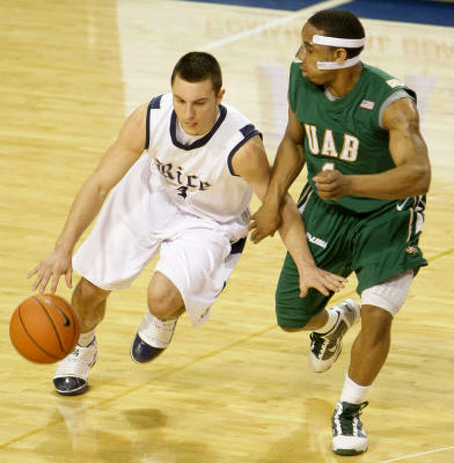 Rice's Connor Frizzelle tries to get past UAB's Aaron Johnson during the first half. Photo: Melissa Phillip, Chronicle