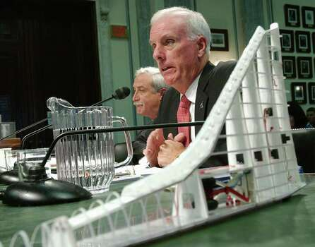 With a model of a space shuttle wing in the foreground, Retired Navy Adm. Harold Gehman, chairman of the Columbia Accident Investigation Board, testifies before the Senate Commerce, Science and Transportation Committee on Capitol Hill Wedensday, Sept. 3, 2002, on the board's investigation of the space shuttle's crash.  NASA Administrator Sean O'Keefe is at left. Photo: DENNIS COOK, AP / AP