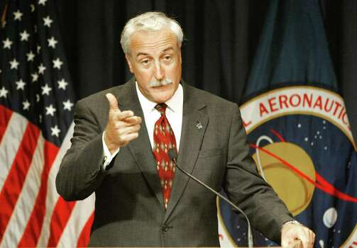 NASA administrator Sean O'Keefe gestures during a Washington news conference Wednesday, Aug. 27, 2003.  O'Keefe said NASA will, without reservation, follow the recommendations of the Columbia Accident Investigation Board, including a major renovation of NASA's culture. Photo: RON EDMONDS, AP / AP
