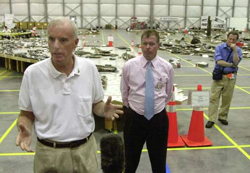 Columbia Accident Investigation Board Chairman (Ret.) Adm. Harold Gehman, Jr. addresses the media in front of a table containing  wreckage of the space shuttle Columbia's left wing at the Kennedy Space Center in Cape Canaveral, Fla. Saturday May 17, 2003. Looking on is board member Dr. Douglas Osheroff, right, and U.S. Rep. Tom Feeney. Photo: PETER COSGROVE, AP / AP