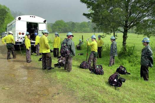 Members of a search crew from Salem, Ore., pack up early for the day Friday, April 4, 2003, during ongoing search efforts for debris from space shuttle Columbia near Woden, Texas. Weather forced the crew to call it a day as thunderstorms with lightning moved through the area. Photo: ANDREW D. BROSIG, AP / THE DAILY SENTINEL