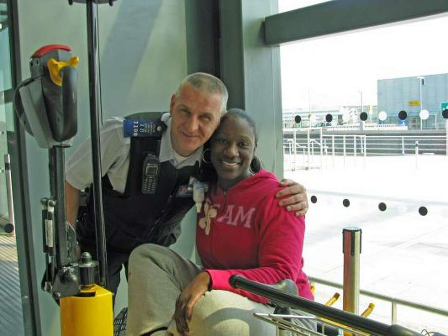 Former Houston resident Renee Bush, spending her third day stranded at Heathrow unable to get home to Atlanta, has forged a new friendship with Glynn Rogers, an airport community officer. Photo: CLAUDIA FELDMAN, Chronicle