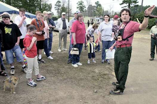 Steve Comeaux, right, points out features of the Incident Command Post camp Sunday, March 16, 2003, at Pineywoods Downs in Nacogdoches, Texas, during a public tour of the facility. Comeaux is working as logistics director for the camp, one of four in East Texas coordinating ongoing search efforts for debris from Space Shuttle Columbia. Photo: ANDREW D. BROSIG, AP / THE DAILY SENTINEL