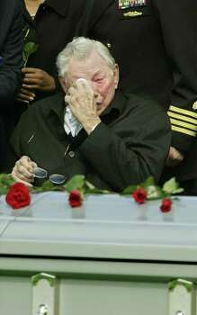 **RETRANSMISSION FOR ALTERNATE CROP**As his father Paul Brown weeps,  space shuttle Columbia mission specialist, Navy Capt. David M. Brown, is buried with full military honors at Arlington National Cemetery,  in Arlington, Va., his home town, Wednesday, March 12, 2003. Brown and six fellow astronauts perished aboard the space shuttle Columbia when it disintegrated  over Texas on Feb. 1, 2003 minutes before it was to land in Florida. Photo: J. SCOTT APPLEWHITE, AP / AP