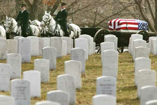The coffin of Columbia shuttle astronaut Michael P. Anderson, draped in the stars and stripes, arrives during a funeral service at Arlington National Cemetery in Arlington, Virginia, Friday, March 7, 2003. Anderson was one of seven astronauts killed in the Columbia shuttle accident last month. Photo: CHARLES DHARAPAK, AP / AP