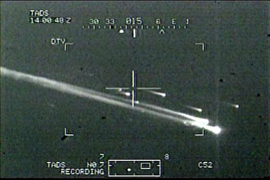 ** ADVANCE FOR SUNDAY, FEB. 19 **FILE**Contrails from the space shuttle Columbia are seen in this image from video taken from an army helicopter and released by the U.S. military, Feb. 12, 2003. Two Dutch military pilots training on an Apache helicopter at Fort Hood, Texas, shot the video of the shuttle breaking up en route to its scheduled landing on Feb. 1. Photo: AP / APTN