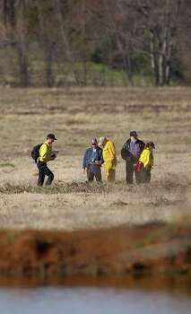 STATE - Searchers look for shuttle debris in a field near Chireno, Texas, on Tuesday, Feb. 4, 2003. Search crews are spread over a wide area of East Texas, looking for parts of Space Shuttle Columbia, which was destroyed upon re-entry into the Earth's atmosphere on Saturday, Fe. 1. BILLY CALZADA / STAFF Photo: BILLY CALZADA, SAN ANTONIO EXPRESS-NEWS / SAN ANTONIO EXPRESS-NEWS