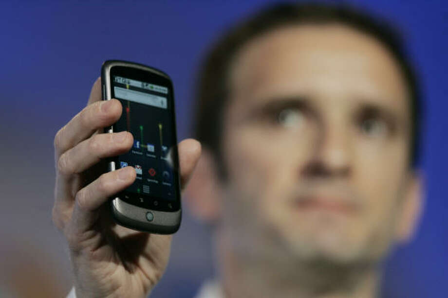 Mario Queiroz, vice president of product management for Google, shows off the phone. Photo: Pool, Getty Images