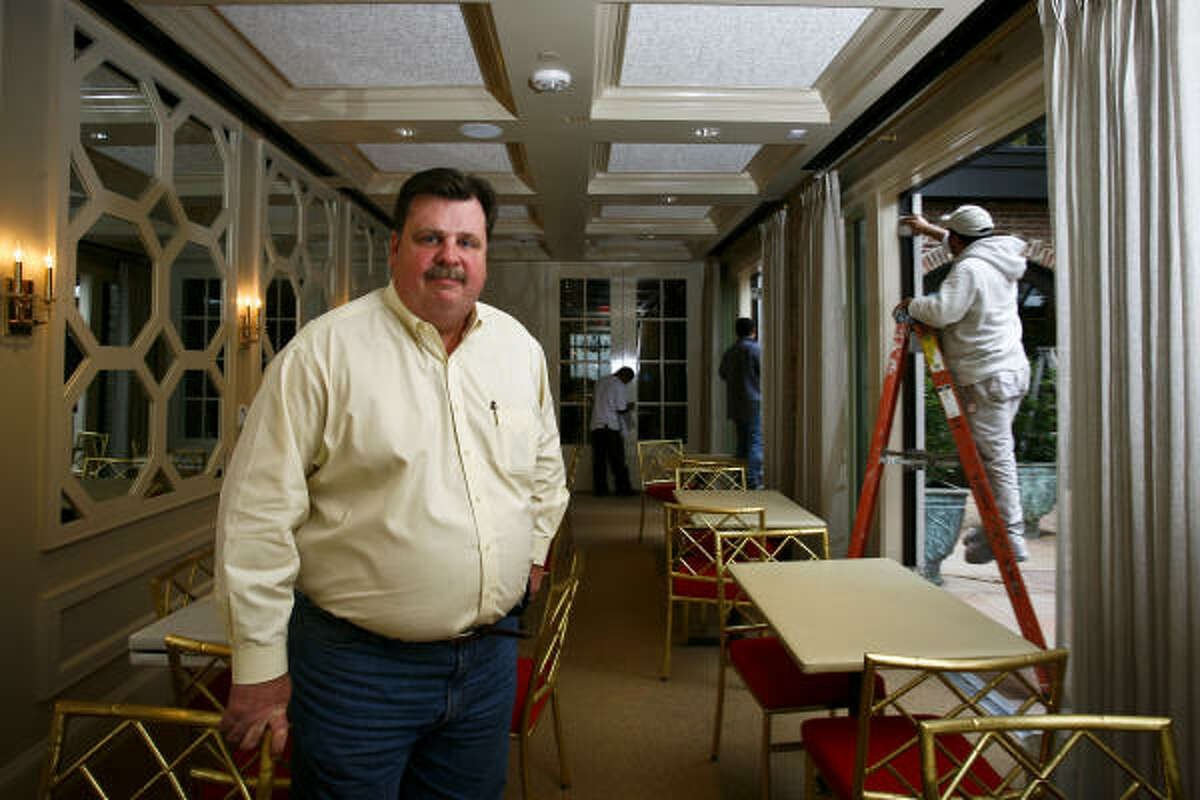 Alex Brennan-Martin, President of Brennan's of Houston, stands in one of the rebuilt dining rooms at Brennan's restaurant, which was nearly destroyed in September 2009 when a transformer fire caused by the whipping winds of Hurricane Ike engulfed the historic building in flames.