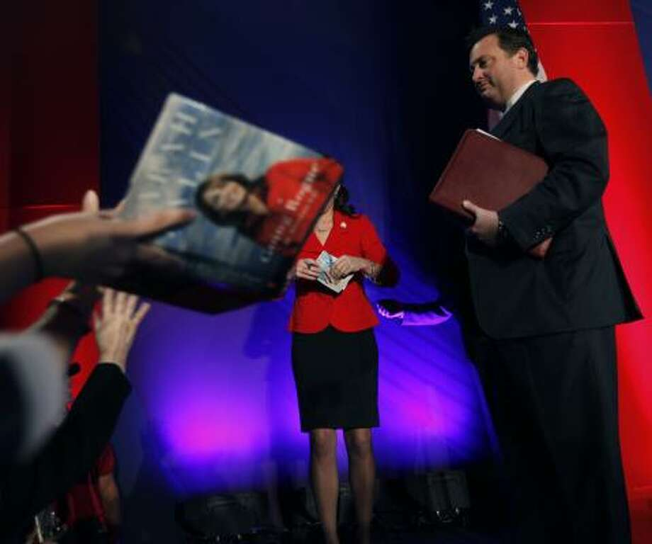 Sarah Palin is seen both on her book cover and live on stage after she spoke at the Southern  Republican Leadership Conference in New Orleans on Friday. Photo: Gerald Herbert, AP