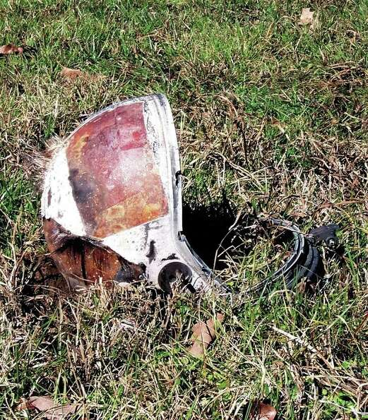 A helmet, believed to have come from the space shuttle Columbia, lies in a field near Lufkin, Texas,