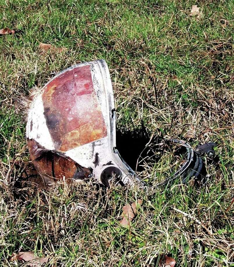 A helmet, believed to have come from the space shuttle Columbia, lies in a field near Lufkin, Texas, Sunday, Feb. 2, 2003. The shuttle tore to pieces Saturday 39 miles above Texas as the spaceship re-entered Earth's atmosphere, killing all seven astronauts. Photo: CHRISTINE DIAMOND, AP / THE LUFKIN DAILY NEWS
